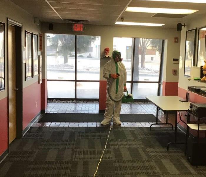 SERVPRO technician getting ready to start misting DISH NETWORK office