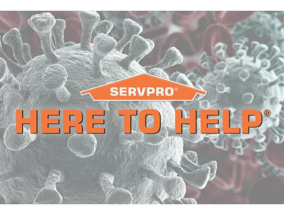 Here to help - image of SERVPRO logo and covid molecules
